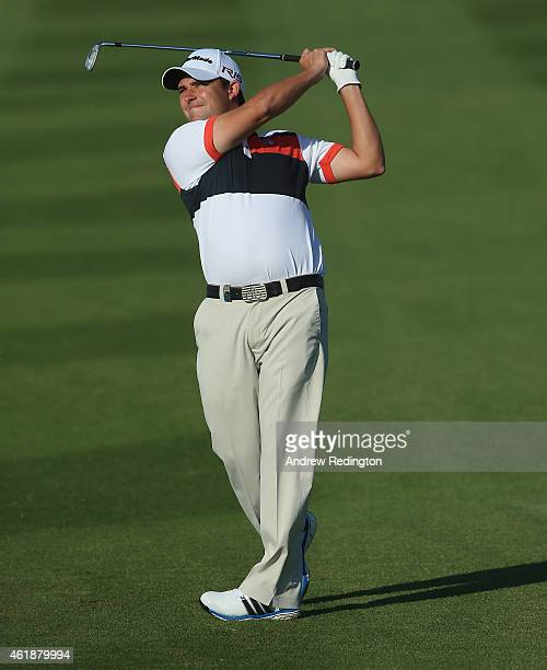 Jason Barnes of England plays his second shot on the 15th hole during the first round of the Commercial Bank Qatar Masters at Doha Golf Club on...