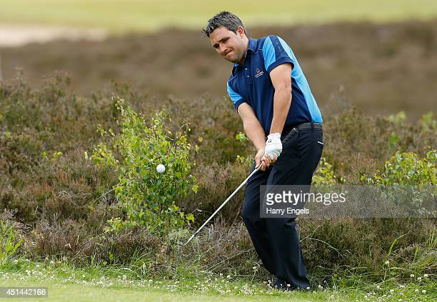 Jason Barnes of England plays out of the rough at the ninth on day four of the 2014 Scottish Hydro Challenge hosted by Macdonald Hotels Resorts at...