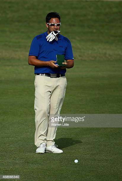 Jason Barnes of England prepares to play his second shot into the 18th green during the third round of the Dubai Festival City Challenge Tour Grand...