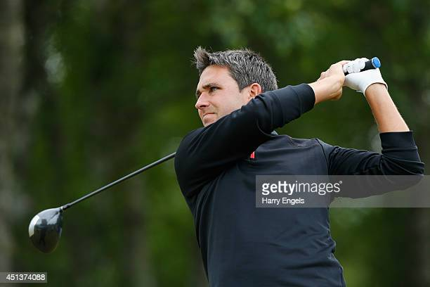Jason Barnes of England tees off at the fourteenth on day three of the 2014 Scottish Hydro Challenge hosted by MacDonald Hotels Resorts at Spey...