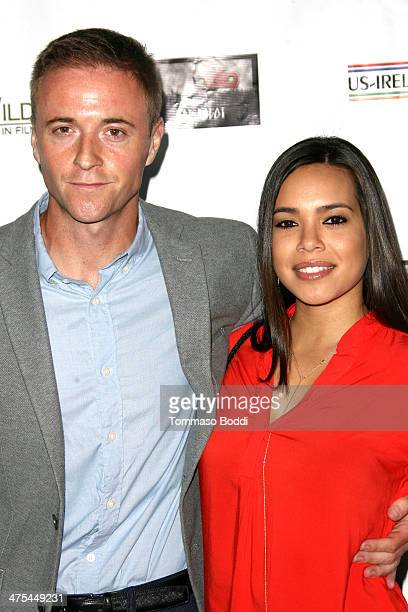 Jason Barry and Kristin Crizaldo attend the USIreland alliance preAcademy Awards event held at Bad Robot on February 27 2014 in Santa Monica...