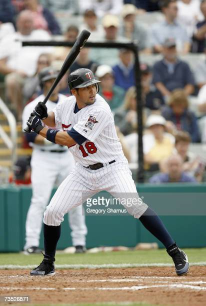 Jason Bartlett of the Minnesota Twins stands ready at bat during a Spring Training game against the Boston Red Sox on March 4, 2007 at Hammond...