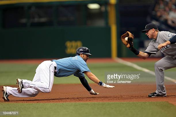 Jason Bartlett of the Tampa Bay Rays is tagged out at first base by Justin Smoak of the Seattle Mariners at Tropicana Field on September 26 2010 in...