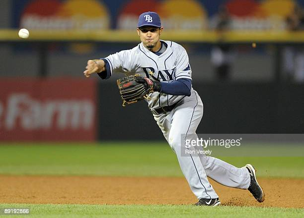 Jason Bartlett of the Tampa Bay Rays throws the ball into the dugout for an error in the seventh inning against the Chicago White Sox on July 22,...