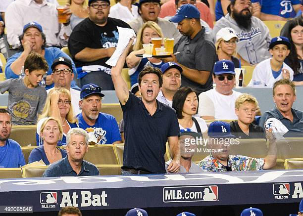 Jason Bateman and Flea attend game one of the National League Division Series between the Los Angeles Dodgers and the New York Mets at Dodger Stadium...