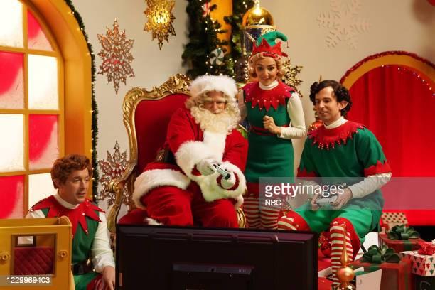 """Jason Bateman"""" Episode 1792 -- Pictured: Beck Bennett as an elf, host Jason Bateman as Santa, Chloe Fineman as an elf, and Kyle Mooney as an elf..."""