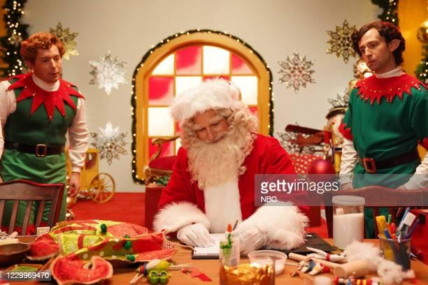 """Jason Bateman"""" Episode 1792 -- Pictured: Beck Bennett as an elf, host Jason Bateman as Santa, and Kyle Mooney as an elf during the """"Stu"""" sketch on..."""