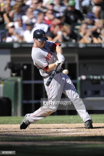 Jason Bay of the Boston Red Sox hits during the game against the Chicago White Sox at US Cellular Field in Chicago Illinois on August 10 2008 The...