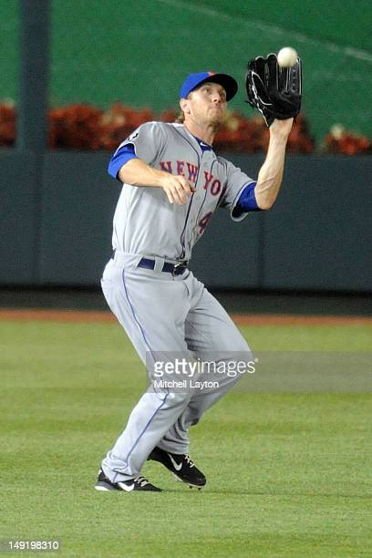 Jason Bay of the New York Mets catches a fly ball during a baseball game against the Washington Nationals on July 17 2012 at Nationals Park in...