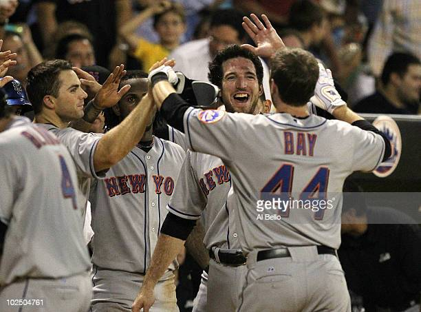 Jason Bay of the New York Mets is greeted at home after hitting a home run against the Florida Marlins during their game at Hiram Bithorn Stadium on...