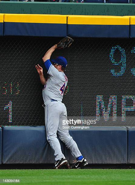Jason Bay of the New York Mets is unable to make a catch against the Atlanta Braves at Turner Field on April 18 2012 in Atlanta Georgia