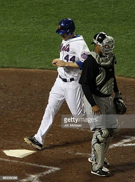 Jason Bay of the New York Mets scores a fourth inning run past Ronny Paulino of the Florida Marlins on April 8 2010 at Citi Field in the Flushing...