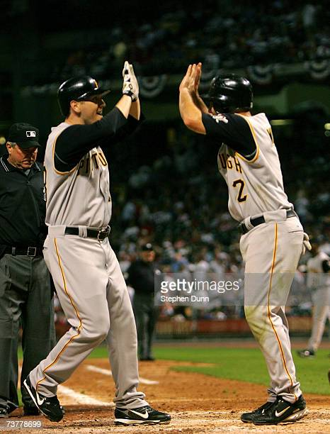 Jason Bay of the Pittsburgh Pirates celebrates with Jack Wilson after Bay's game winning two run home run in the tenth inning on April 2 2007 at...