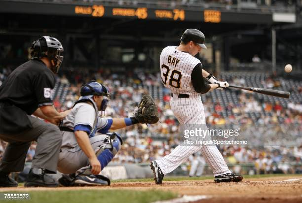 Jason Bay of the Pittsburgh Pirates hits a homerun against the Los Angeles Dodgers on June 3, 2007 at PNC Park in Pittsburgh, Pennsylvania. The...