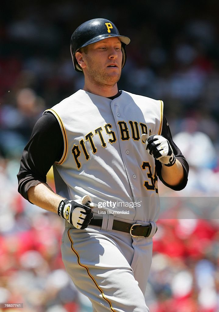 Jason Bay #38 of the Pittsburgh Pirates runs to first base during the game against the Los Angeles Angels of Anaheim at Angels Stadium on June 24, 2007 in Anaheim, California.