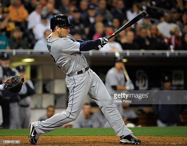 Jason Bay of the Seattle Mariners hits a solo home run during the ninth inning of a baseball game against the San Diego Padres at Petco Park on May...
