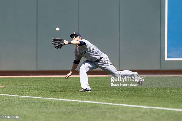 Jason Bay of the Seattle Mariners makes a diving catch against the Minnesota Twins on June 2 2013 at Target Field in Minneapolis Minnesota The Twins...
