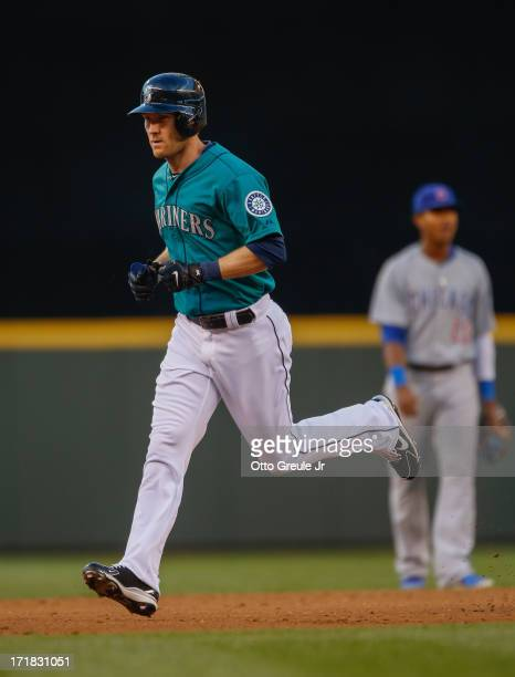 Jason Bay of the Seattle Mariners rounds the bases after hitting a home run against the Chicago Cubs in the fifth inning at Safeco Field on June 28...