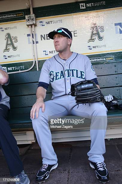 Jason Bay of the Seattle Mariners sits in the dugout prior to the game against the Oakland Athletics at Oco Coliseum on June 14 2013 in Oakland...