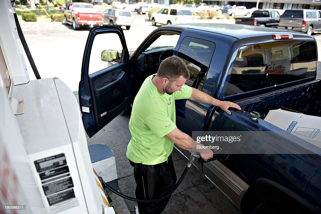 Jason Beck puts fuel in his vehicle at a gas station in Peoria, Illinois, U.S., on Wednesday, Sept. 11, 2013. Gasoline climbed in New York trading as crude advanced before talks between the U.S. and Russia over disposing of Syrias chemical weapons and as U.S. jobless claims dropped. Photographer: Daniel Acker/Bloomberg via Getty Images