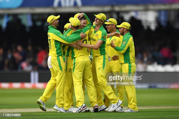 Jason Behrendorff of Australia celebrates with his team mates after taking the wicket of Jofra Archer of England, his fifth wicket of the day during...