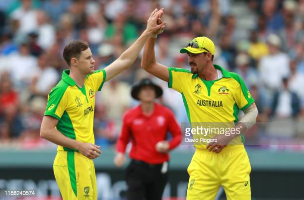 Jason Behrendorff of Australia celebrates with team mate Mitchell Starc after taking the wicket of Moeen Ali during the Group Stage match of the ICC...