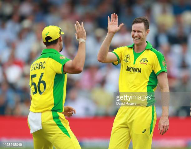 Jason Behrendorff of Australia celebrates with team mate Mitchell Starc after taking the wicket of Jonny Bairstow during the Group Stage match of the...