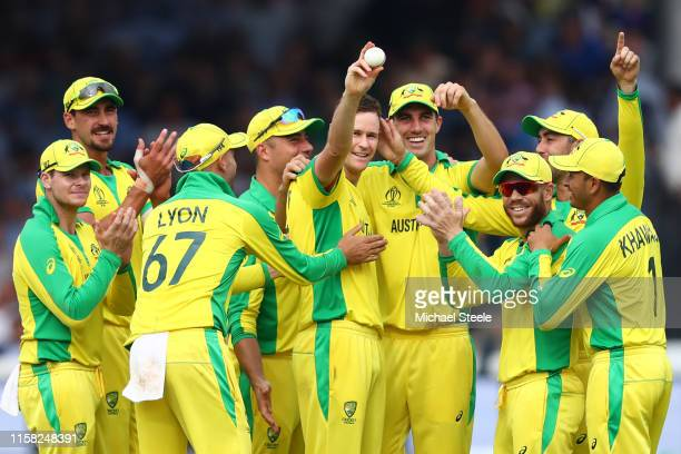 Jason Behrendorff of Australia holds up the ball after taking 5 wickets for 44 runs during the Group Stage match of the ICC Cricket World Cup 2019...