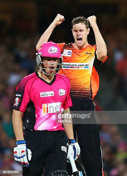 Jason Behrendorff of the Scorchers celebrates taking the wicket of Moises Henriques of the Sixers during the Big Bash League match between the Sydney...