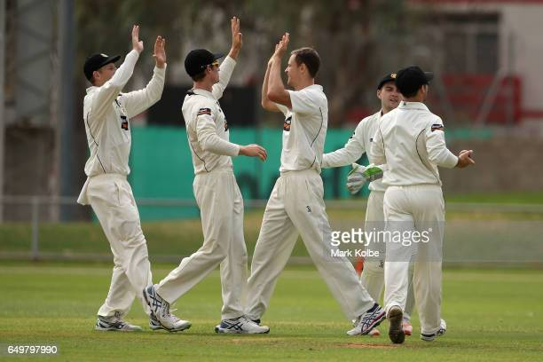 Jason Behrendorff of the Warriors celebrates with his team mates after taking the wicket of Dan Christian of the Bushrangers during the Sheffield...
