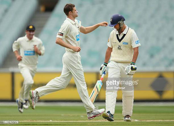 Jason Behrendorff of Western Australia celebrates after dismissing Rob Quiney of Victoria during day one of the Sheffield Shield match between the...