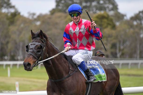 Jason Benbow returns to the mounting yard on Noumea after winning the Bet365 Coleraine Cup at Coleraine Racecourse on September 23 2018 in Coleraine...