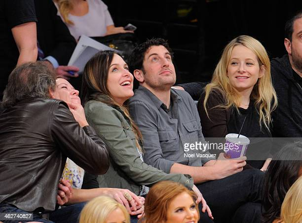 Jason Biggs and his wife Jenny Mollen attend a basketball game between the Clevland Cavieliers and the Los Angeles Lakers at Staples Center on...