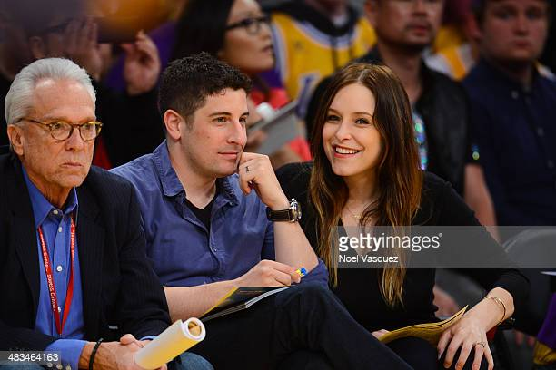 Jason Biggs and Jenny Mollen attend a basketball game between the Houston Rockets and the Los Angeles Lakers at Staples Center on April 8, 2014 in...