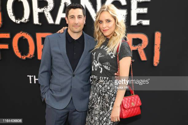 Jason Biggs and Jenny Mollen attend the Orange is the New Black final season world premiere at Alice Tully Hall Lincoln Center on July 25 2019 in New...