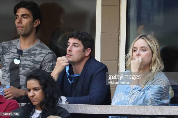 Jason Biggs and Jenny Mollen watch the Men's Singles finals match between Kevin Anderson of South Africa and Rafael Nadal of Spain on Day Fourteen of...