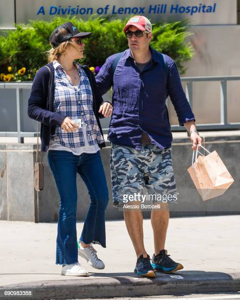 Jason Biggs and wife Jenny Mollen are seen walking in West Village after having breakfast at Sant Ambroeus on May 31 2017 in New York City