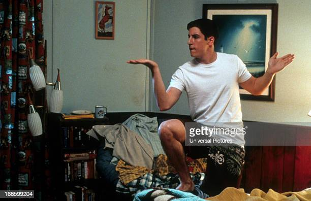 Jason Biggs dancing around on messy bed in a scene from the film 'American Pie 2' 2001
