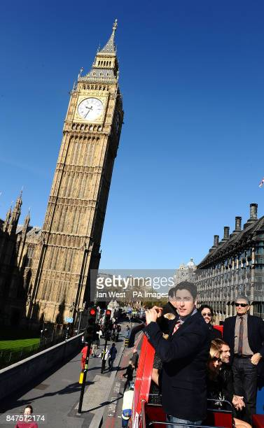 Jason Biggs takes photos of the Palace Of Westminster while on an open top bus to promote his new film American PieReunion in London