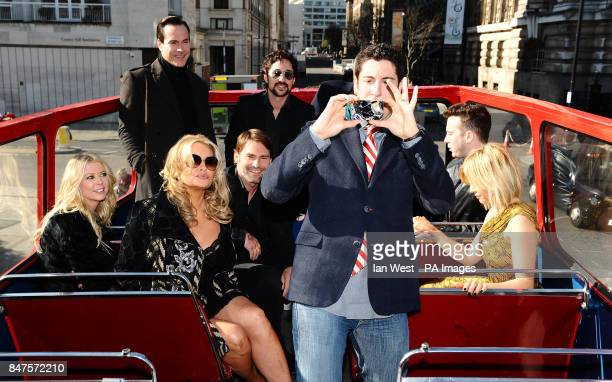 Jason Biggs takes photos of the press while on an open top bus in London to promote his new film American PieReunion