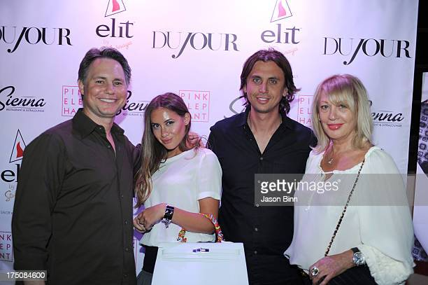 Jason Binn Anat Popovsky Jonathan Cheban and Galina Cheban visit the Sienna Restaurant at Pink Elephant on July 27 2013 in East Hampton City