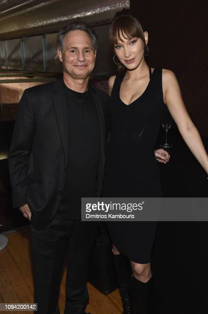 Jason Binn and Bella Hadid attends the Jump Into Spring MICHAEL Michael Kors Spring 2019 Launch Party at Dolby Soho on February 5 2019 in New York...
