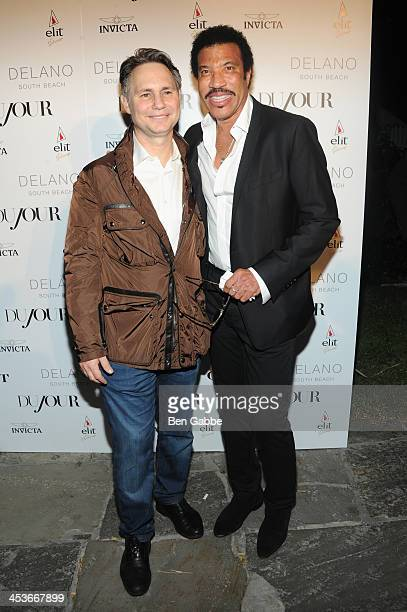 Jason Binn and Lionel Richie attend DuJour Magazine's event to honor artist Marc Quinn at Delano South Beach Club on December 4 2013 in Miami Beach...