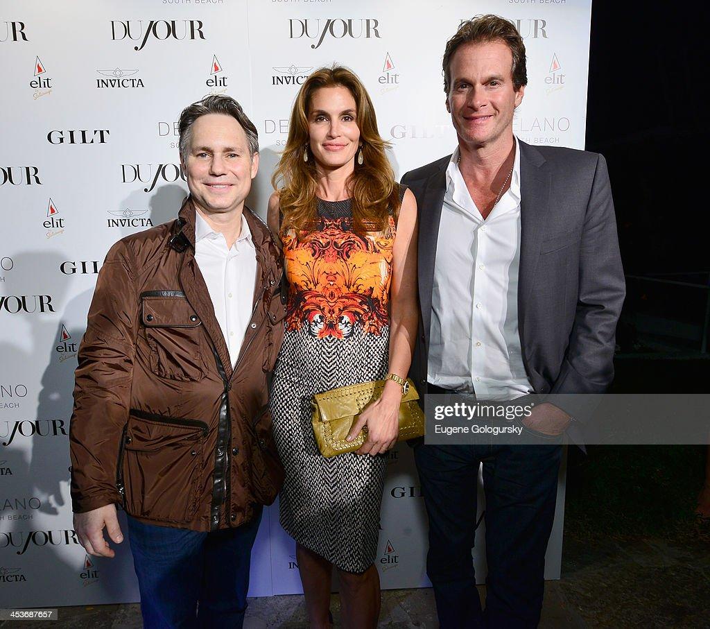 Jason Binn, Cindy Crawford and Rande Gerber attend DuJour Magazine's event to honor artist Marc Quinn at Delano South Beach Club on December 4, 2013 in Miami Beach, Florida.