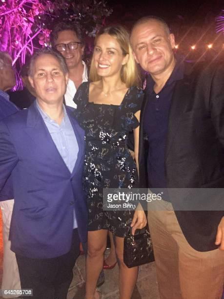 Jason Binn, Petra Nemcova, Ronn Torossian circa December 2016 in Miami, Florida.