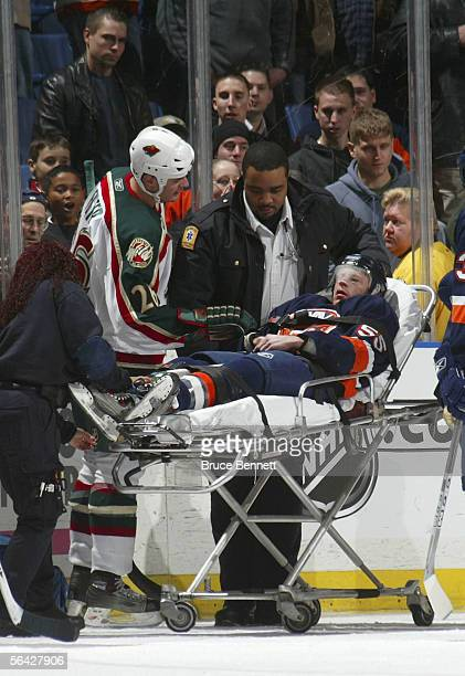 Jason Blake of the New York Islanders is taken off the ice after being injured in the third period against the Minnesota Wild on December 13, 2005 at...
