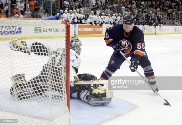Jason Blake of the New York Islanders scores a shootout goal against Sebastien Caron of the Pittsburgh Penguins on April 15, 2006 at the Nassau...