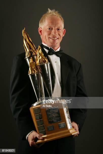 Jason Blake of the Toronto Maple Leafs poses with the Bill Masterton Memorial Torphy during the 2008 NHL Awards at the at the Elgin Theatre on June...