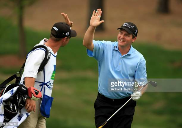 Jason Bohn celebrates pitching in for birdie on the 3rd hole during the third round of the Wachovia Championship at Quail Hollow Country Club on May...
