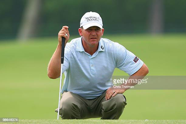 Jason Bohn lines up a putt on the 13th hole during the continuation of the weather delayed second round of the Zurich Classic at TPC Louisiana on...